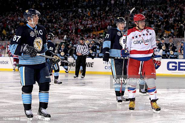 Alex Ovechkin of the Washington Capitals looks on alongside Sidney Crosby Evgeni Malkin of the Pittsburgh Penguins during the 2011 NHL Bridgestone...