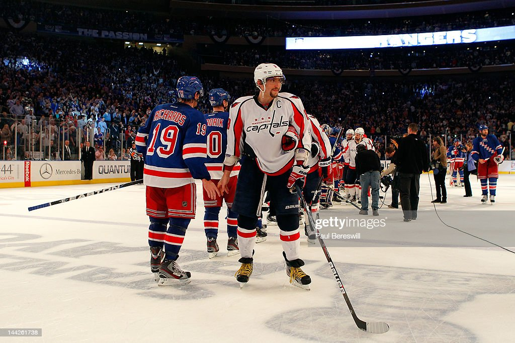 Alex Ovechkin #8 of the Washington Capitals looks on dejected after he congratulated <a gi-track='captionPersonalityLinkClicked' href=/galleries/search?phrase=Brad+Richards&family=editorial&specificpeople=202622 ng-click='$event.stopPropagation()'>Brad Richards</a> #19 of the New York Rangers on the Rangers 2-1 win in Game Seven of the Eastern Conference Semifinals during the 2012 NHL Stanley Cup Playoffs at Madison Square Garden on May 12, 2012 in New York City.