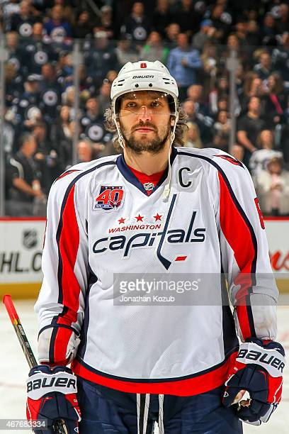 Alex Ovechkin of the Washington Capitals looks on prior to puck drop against the Winnipeg Jets on March 21 2015 at the MTS Centre in Winnipeg...