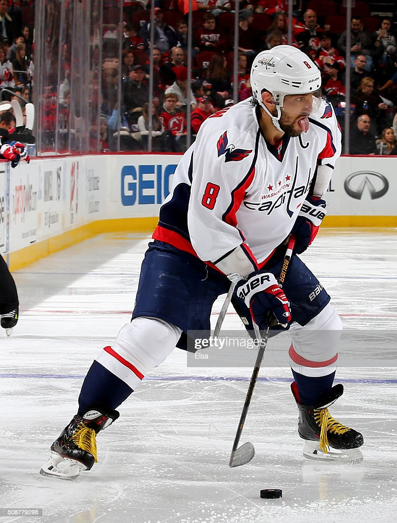 Alex Ovechkin #8 of the Washington Capitals looks to pass in the third period against the New Jersey Devils on February 6, 2016 at Prudential Center in Newark, New Jersey.The Washington Capitals defeated the New Jersey Devils 3-2 in an overtime shootout.