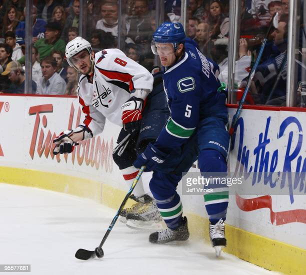 Alex Ovechkin of the Washington Capitals loses his stick as Christian Ehrhoff of the Vancouver Canucks plays the puck during their game at General...