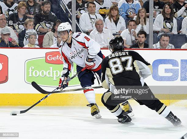 Alex Ovechkin of the Washington Capitals moves the puck in front of Sidney Crosby of the Pittsburgh Penguins during Game Four of the Eastern...