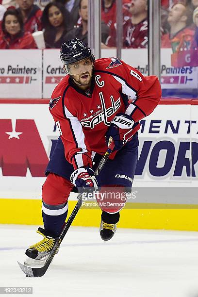 Alex Ovechkin of the Washington Capitals moves the puck up ice in the third period against the New Jersey Devils during the Capitals NHL season...