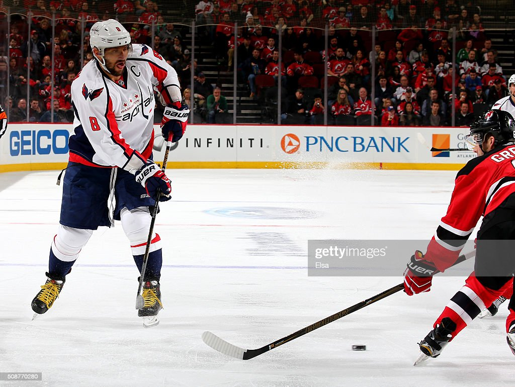 Alex Ovechkin #8 of the Washington Capitals passes the puck as <a gi-track='captionPersonalityLinkClicked' href=/galleries/search?phrase=Andy+Greene&family=editorial&specificpeople=3568726 ng-click='$event.stopPropagation()'>Andy Greene</a> #6 of the New Jersey Devils defends on February 6, 2016 at Prudential Center in Newark, New Jersey.