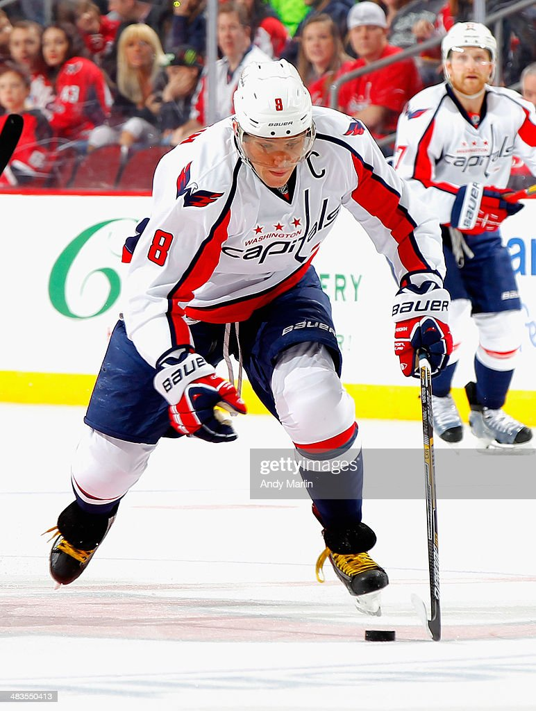 Alex Ovechkin #8 of the Washington Capitals plays the puck against the New Jersey Devils during the game at the Prudential Center on April 4, 2014 in Newark, New Jersey.