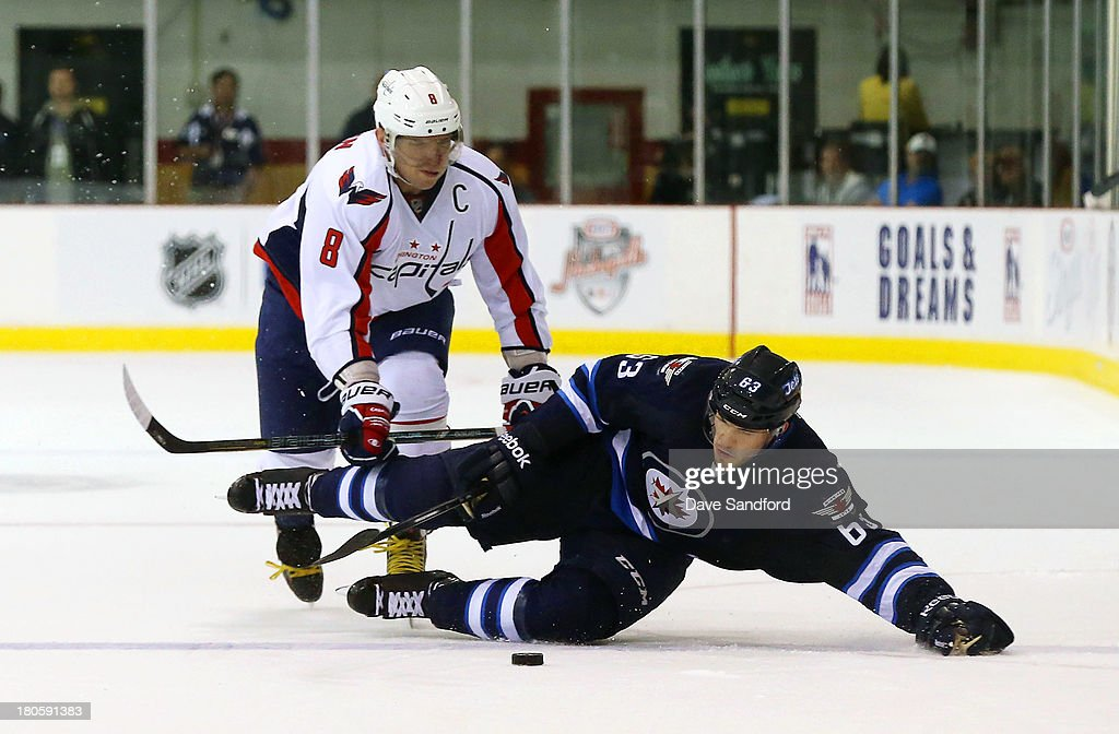Alex Ovechkin #8 of the Washington Capitals puts a check on Ben Chiarot #63 of the Winnipeg Jets during Kraft Hockeyville Day 2 at Yardmen Arena on September 14, 2013 in Belleville, Ontario, Canada.