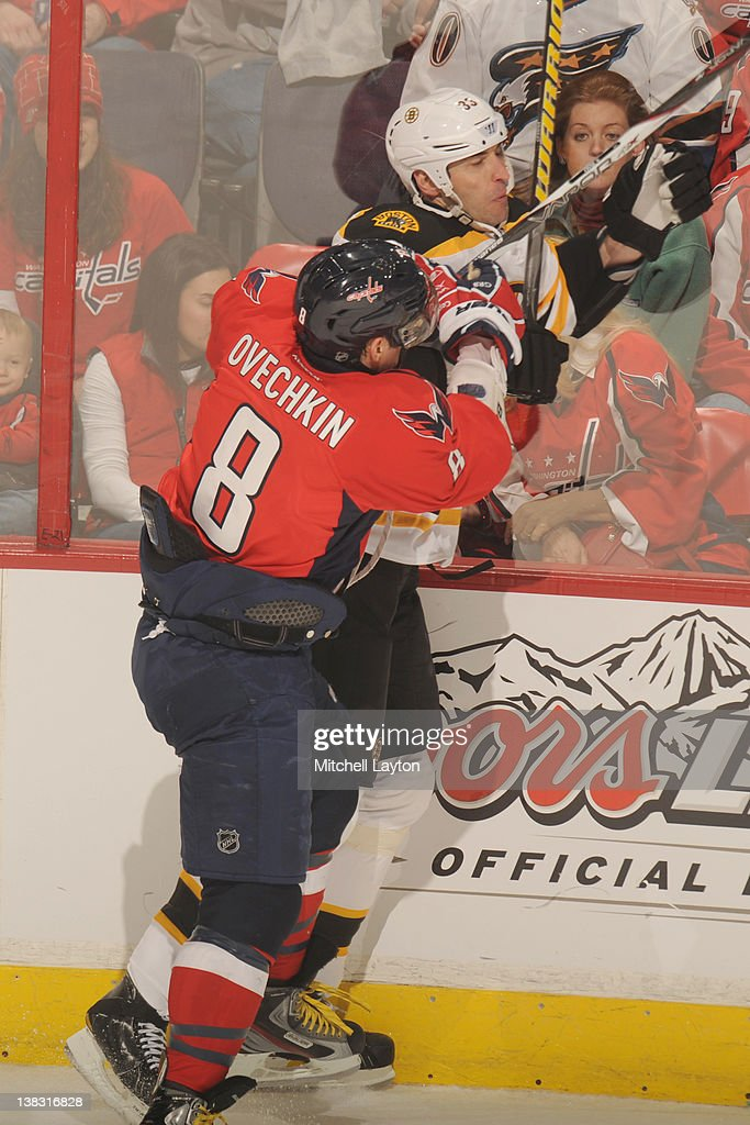 Alex Ovechkin #8 of the Washington Capitals puts a hit on <a gi-track='captionPersonalityLinkClicked' href=/galleries/search?phrase=Zdeno+Chara&family=editorial&specificpeople=203177 ng-click='$event.stopPropagation()'>Zdeno Chara</a> #33 of the Boston Bruins during an NHL hockey game on February 5, 2012 at the Verizon Center in Washington, DC.