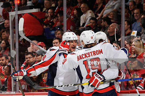 Alex Ovechkin of the Washington Capitals reacts after Marcus Johansson scored in the first period of the NHL game against the Chicago Blackhawks at...