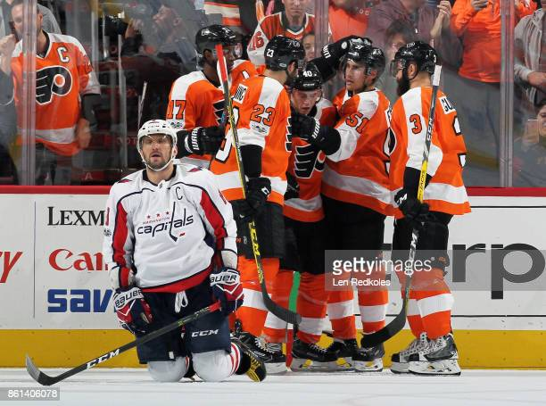 Alex Ovechkin of the Washington Capitals reacts as Valtteri Filppula of the Philadelphia Flyers celebrates his second period goal with teammates...