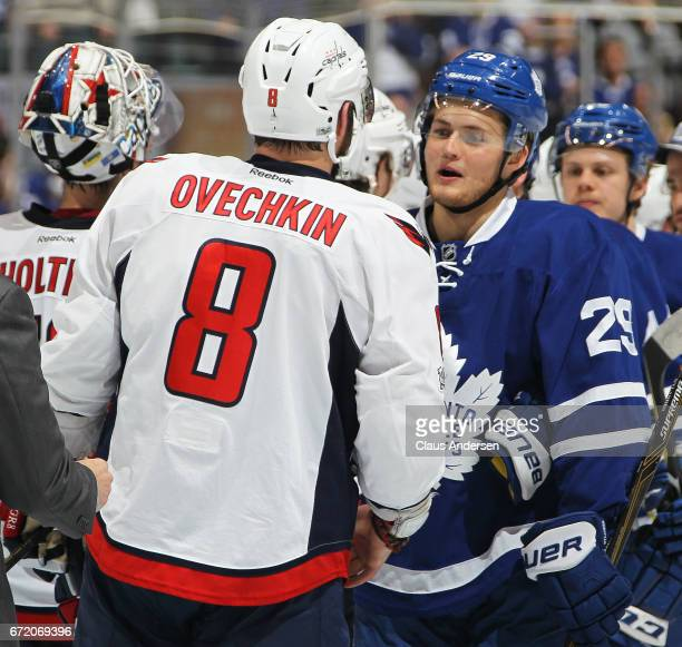 Alex Ovechkin of the Washington Capitals receives congratulations from William Nylander of the Toronto Maple Leafs after Game Six of the Eastern...