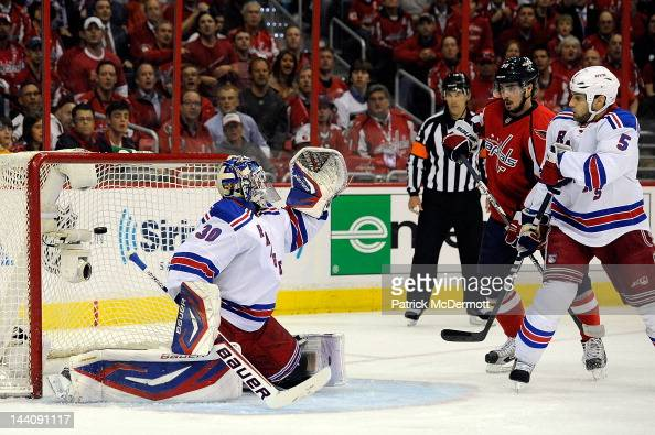Alex Ovechkin of the Washington Capitals scores a goal against Henrik Lundqvist of the New York Rangers as Marcus Johansson and Dan Girardi battle in...