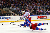 Alex Ovechkin of the Washington Capitals scores a goal in the first period past Ryan McDonagh of the New York Rangers in Game Seven of the Eastern...