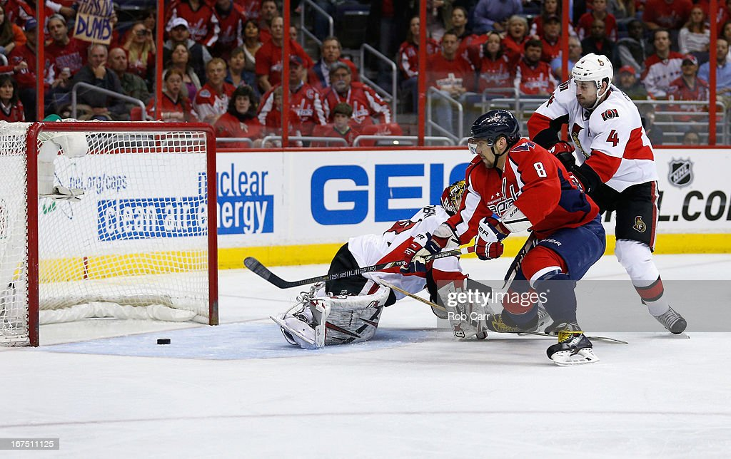 Alex Ovechkin #8 of the Washington Capitals scores a third period goal in front of goalie <a gi-track='captionPersonalityLinkClicked' href=/galleries/search?phrase=Craig+Anderson&family=editorial&specificpeople=211238 ng-click='$event.stopPropagation()'>Craig Anderson</a> #41 and Chris Phillips #4 of the Ottawa Senators during the Senators 2-1 overtime win at Verizon Center on April 25, 2013 in Washington, DC.