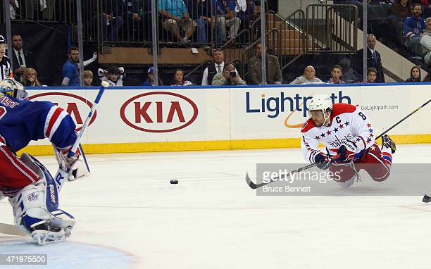 Alex Ovechkin of the Washington Capitals scores a third period goal against Henrik Lundqvist of the New York Rangers in Game Two of the Eastern...