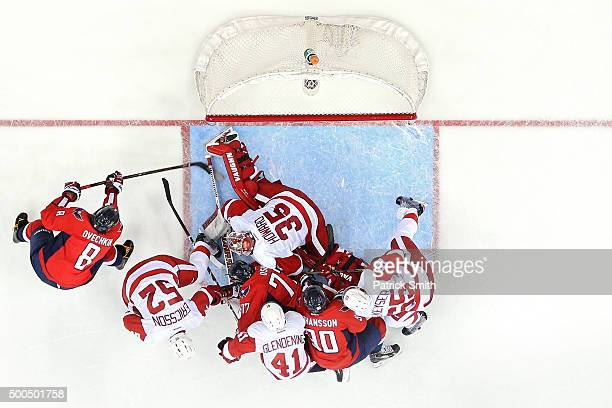 Alex Ovechkin of the Washington Capitals scores a third period goal past goalie Jimmy Howard of the Detroit Red Wings at Verizon Center on December 8...