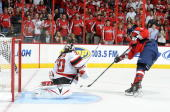 Alex Ovechkin of the Washington Capitals scores on a penalty shot in the second period against Martin Brodeur of the New Jersey Devils at the Verizon...
