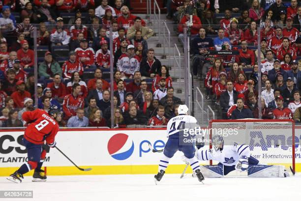 Alex Ovechkin of the Washington Capitals scores the game winning goal in overtime on Frederik Andersen of the Toronto Maple Leafs during an NHL game...