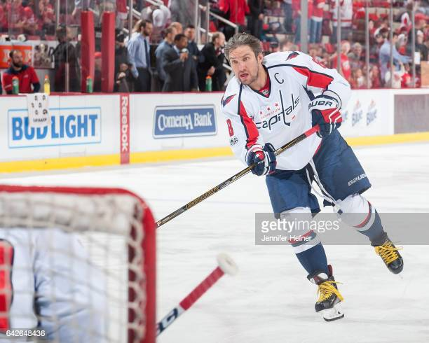Alex Ovechkin of the Washington Capitals shoots the puck in warmups prior to an NHL game against the Detroit Red Wings at Joe Louis Arena on February...
