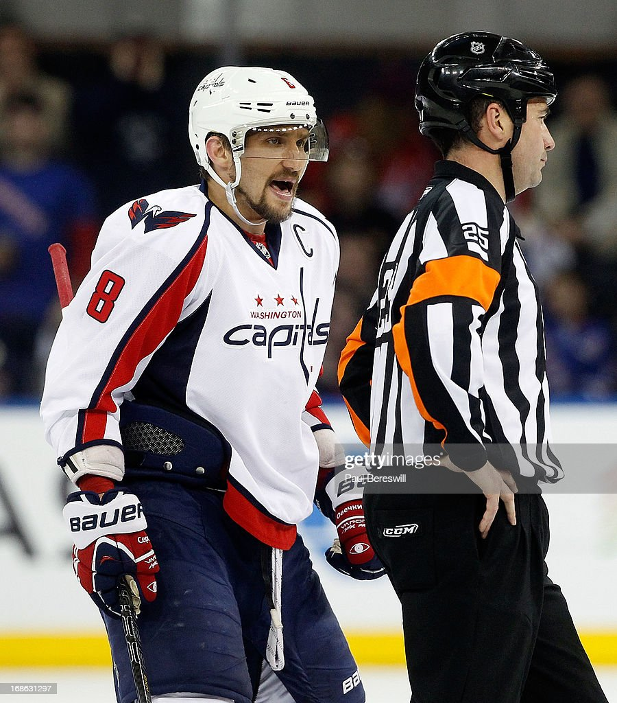 Alex Ovechkin #8 of the Washington Capitals shouts at referee Mark Joannette #25 after the Capitals received a penalty in the second period in Game Six of the Eastern Conference Quarterfinals during the 2013 NHL Stanley Cup Playoffs at Madison Square Garden on May 12, 2013 in New York City. Rangers won 1-0.