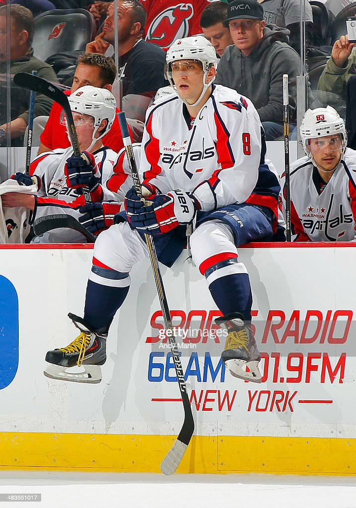 Alex Ovechkin #8 of the Washington Capitals sits on the boards during a timeout against the New Jersey Devils during the game at the Prudential Center on April 4, 2014 in Newark, New Jersey.