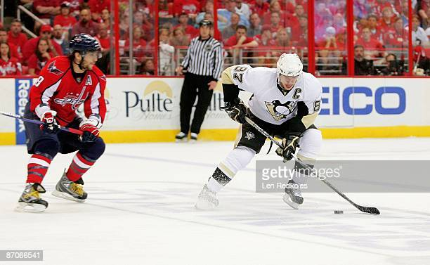 Alex Ovechkin of the Washington Capitals skates after Sidney Crosby of the Pittsburgh Penguins during Game Five of the Eastern Conference Semifinal...