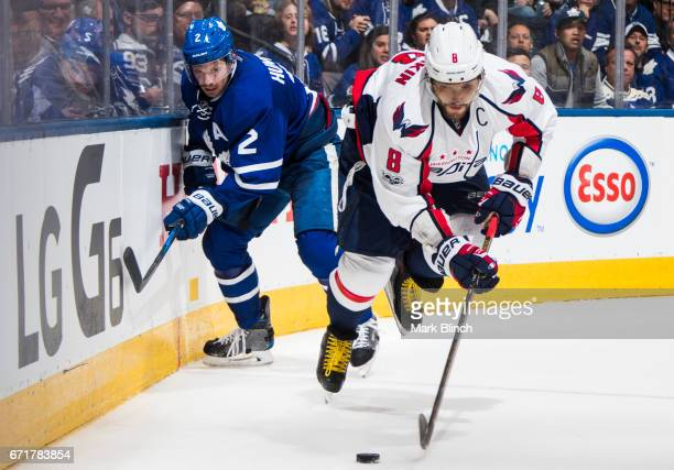 Alex Ovechkin of the Washington Capitals skates against Matt Hunwick of the Toronto Maple Leafs during the second period in Game Four of the Eastern...
