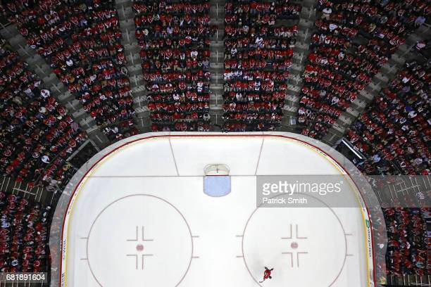 Alex Ovechkin of the Washington Capitals skates alone on the ice during a stop in play during the first period against the Pittsburgh Penguins in...