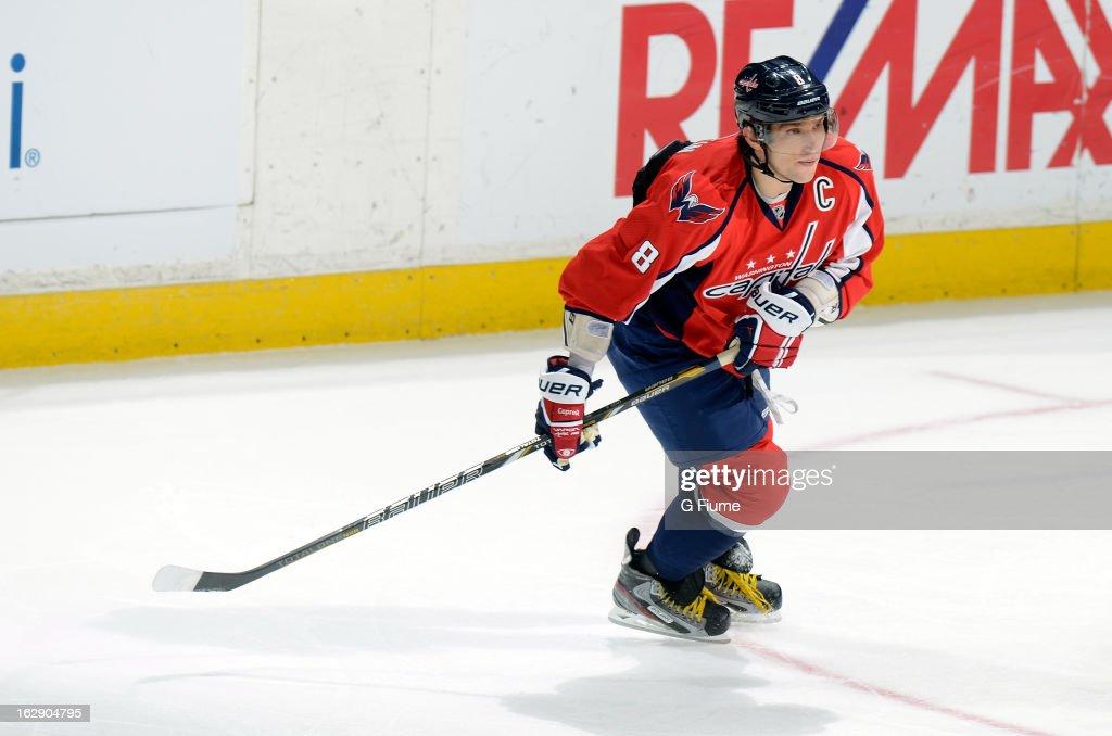 Alex Ovechkin #8 of the Washington Capitals skates down the ice against the Carolina Hurricanes at the Verizon Center on February 26, 2013 in Washington, DC.