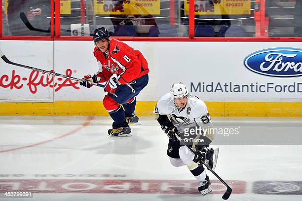 Alex Ovechkin of the Washington Capitals skates down the ice against Sidney Crosby of the Pittsburgh Penguins at the Verizon Center on November 20...