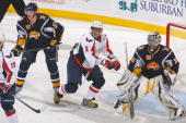 Alex Ovechkin of the Washington Capitals skates into position against goalie Ryan Miller of the Buffalo Sabres at HSBC Arena on December 9 2009 in...