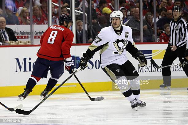 Alex Ovechkin of the Washington Capitals skates past Sidney Crosby the Pittsburgh Penguins in the first period in Game One of the Eastern Conference...
