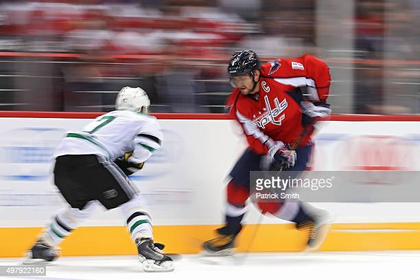Alex Ovechkin of the Washington Capitals skates with the puck in front of Johnny Oduya of the Dallas Stars in the second period at Verizon Center on...