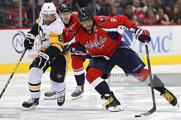 Alex Ovechkin of the Washington Capitals skates with the puck past Trevor Daley of the Pittsburgh Penguins during the second period at Verizon Center...