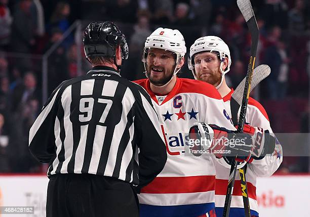 Alex Ovechkin of the Washington Capitals speks with referee Jean Morin after defeating the Montreal Canadiens in the NHL game at the Bell Centre on...