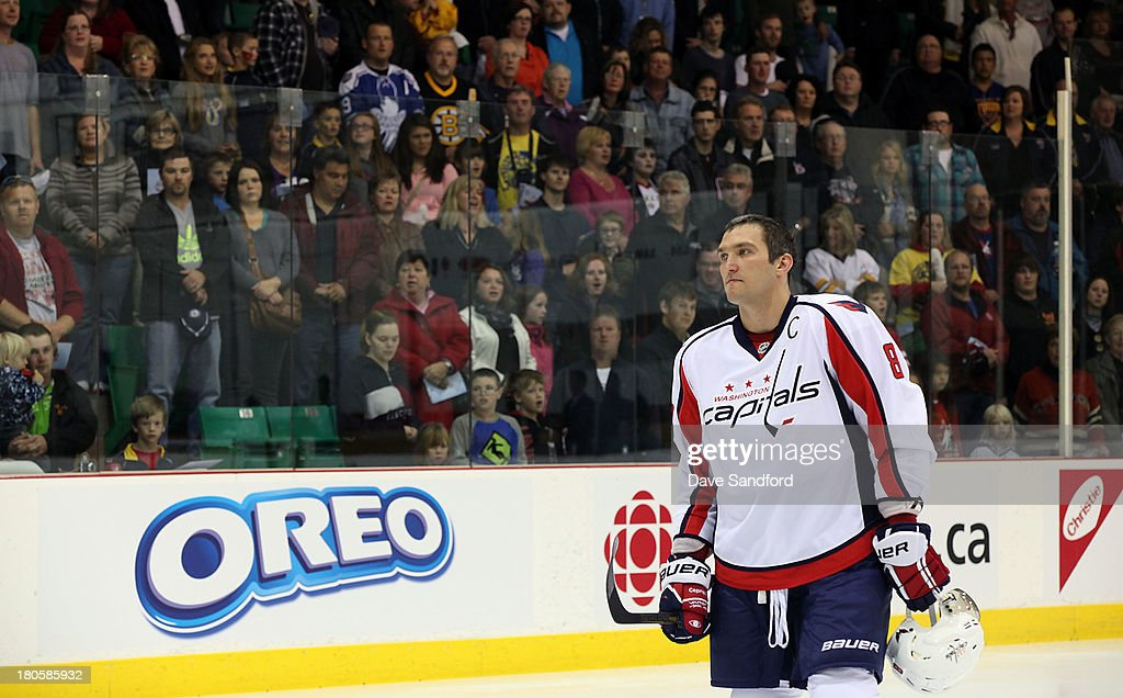 Alex Ovechkin #8 of the Washington Capitals stands for the national anthems prior to facing the Winnipeg Jets during Kraft Hockeyville Day 2 at Yardman Arena on September 14, 2013 in Belleville, Ontario, Canada.