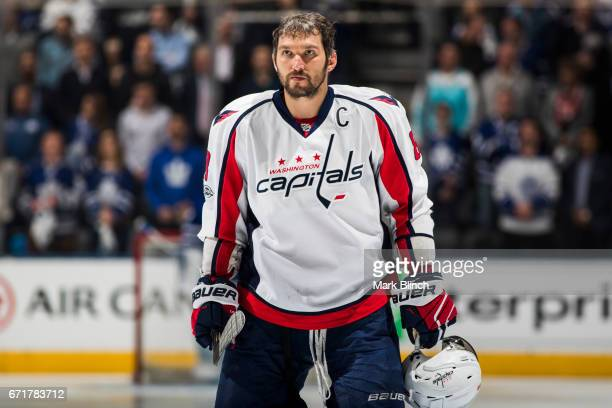 Alex Ovechkin of the Washington Capitals stands for the national anthem prior to playing the Toronto Maple Leafs in Game Four of the Eastern...