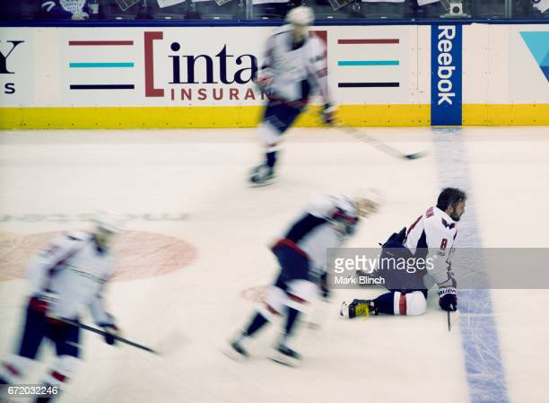 Alex Ovechkin of the Washington Capitals stretches as his teammates skate around him prior to facing the Toronto Maple Leafs in Game Six of the...