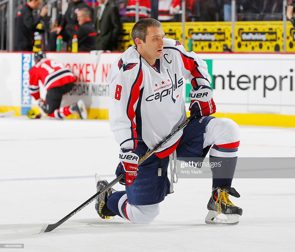 Alex Ovechkin #8 of the Washington Capitals stretches during pregame warmups prior to the game against the New Jersey Devils at the Prudential Center on April 4, 2014 in Newark, New Jersey.