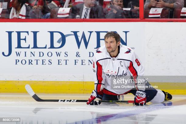Alex Ovechkin of the Washington Capitals stretches during warmups prior to a game against the Ottawa Senators at Canadian Tire Centre on October 5...