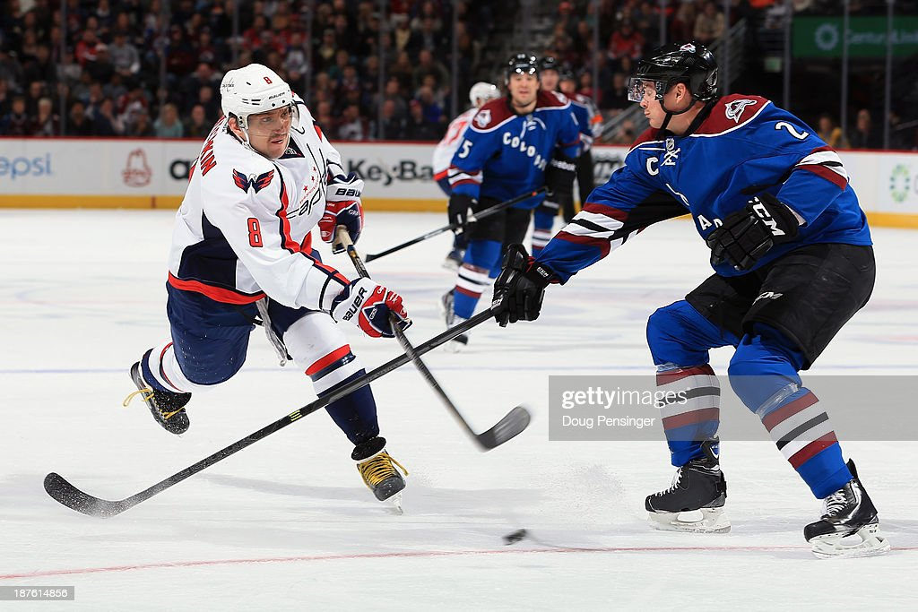 Alex Ovechkin #8 of the Washington Capitals takes a shot against <a gi-track='captionPersonalityLinkClicked' href=/galleries/search?phrase=Nick+Holden&family=editorial&specificpeople=5635993 ng-click='$event.stopPropagation()'>Nick Holden</a> #2 of the Colorado Avalanche at Pepsi Center on November 10, 2013 in Denver, Colorado.