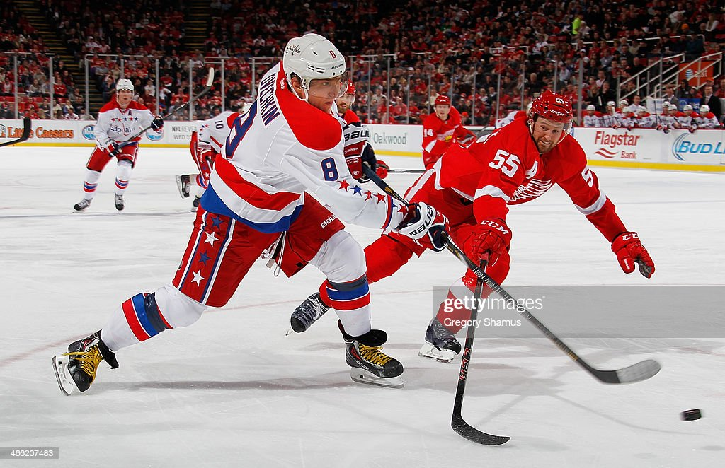 Alex Ovechkin #8 of the Washington Capitals takes a third-period shot around the stick of <a gi-track='captionPersonalityLinkClicked' href=/galleries/search?phrase=Niklas+Kronwall&family=editorial&specificpeople=220826 ng-click='$event.stopPropagation()'>Niklas Kronwall</a> #55 of the Detroit Red Wings at Joe Louis Arena on January 31, 2014 in Detroit, Michigan. Detroit won 4-3 in a shootout.