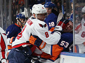 Alex Ovechkin of the Washington Capitals takes a two minute roughing penalty against Casey Cizikas of the New York Islanders at the Nassau Veterans...
