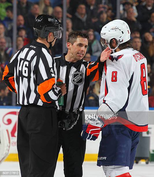 Alex Ovechkin of the Washington Capitals talks to referees Dave Lewis and Chris Rooney during an NHL game against the Buffalo Sabres on December 28...