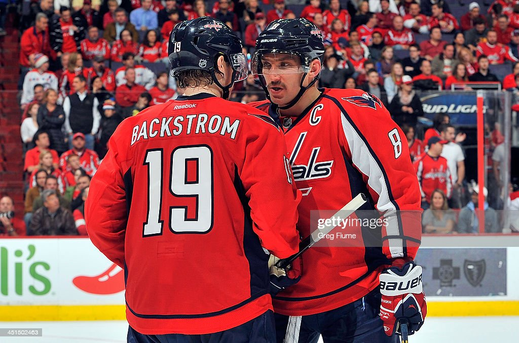 Alex Ovechkin of the Washington Capitals talks with teammate Nicklas Backstrom in the third period against the Montreal Canadiens at the Verizon...