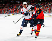Alex Ovechkin of the Washington Capitals tangles with Filip Kuba of the Florida Panthers at the BBT Center on February 12 2013 in Sunrise Florida