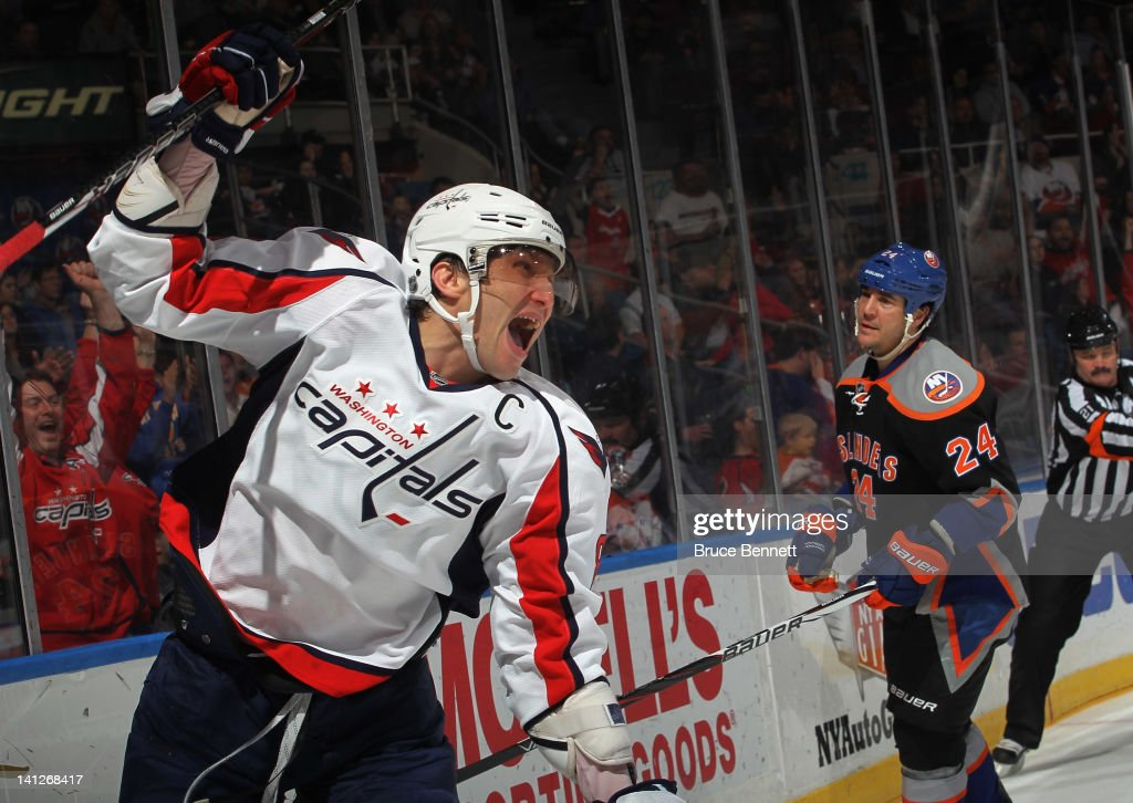 Alex Ovechkin #8 of the Washington Capitals ties the score at 4-4 at 10:15 of the third period against the New York Islanders at the Nassau Veterans Memorial Coliseum on March 13, 2012 in Uniondale, New York. The Capitals defeated the Islanders 5-4 in the shootout.