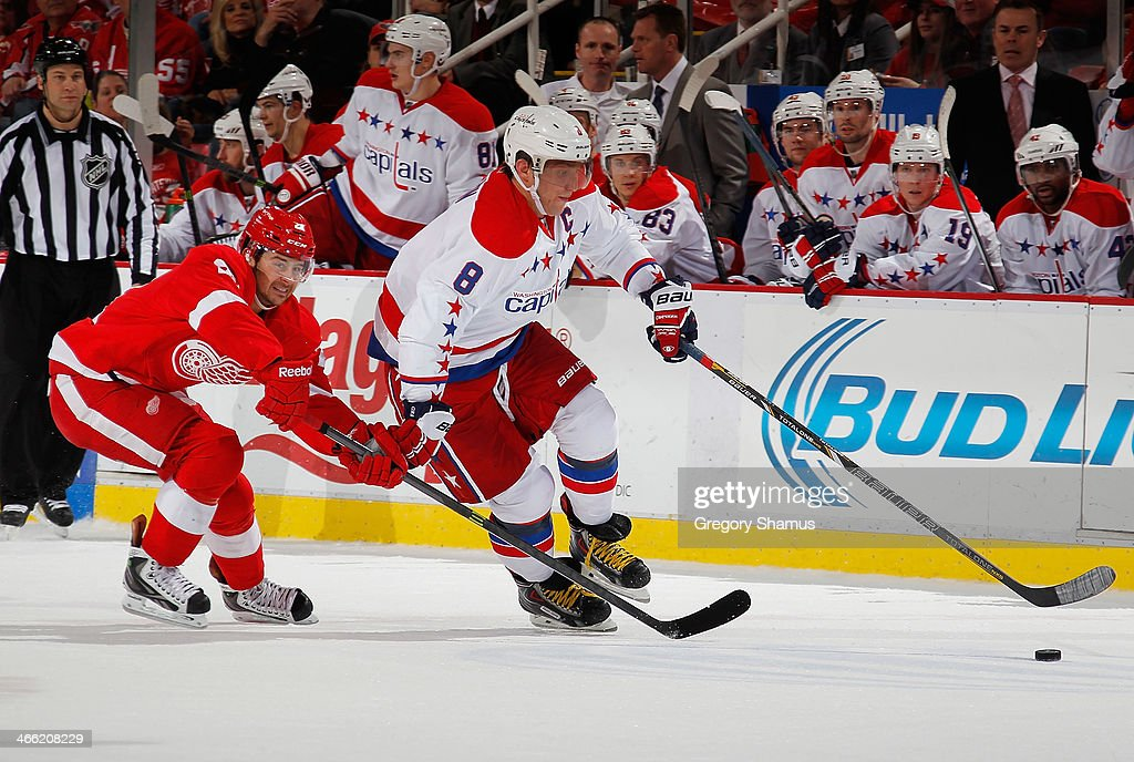 Alex Ovechkin #8 of the Washington Capitals tries to get around the stick of <a gi-track='captionPersonalityLinkClicked' href=/galleries/search?phrase=Tomas+Tatar&family=editorial&specificpeople=5652303 ng-click='$event.stopPropagation()'>Tomas Tatar</a> #21 of the Detroit Red Wings during the third period at Joe Louis Arena on January 31, 2014 in Detroit, Michigan. Detroit won in a 4-3 in a shootout.
