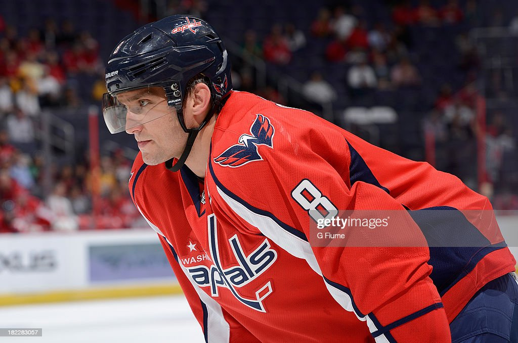 Alex Ovechkin #8 of the Washington Capitals waits for a face-off against the Nashville Predators during a preseason game at the Verizon Center on September 25, 2013 in Washington, DC.