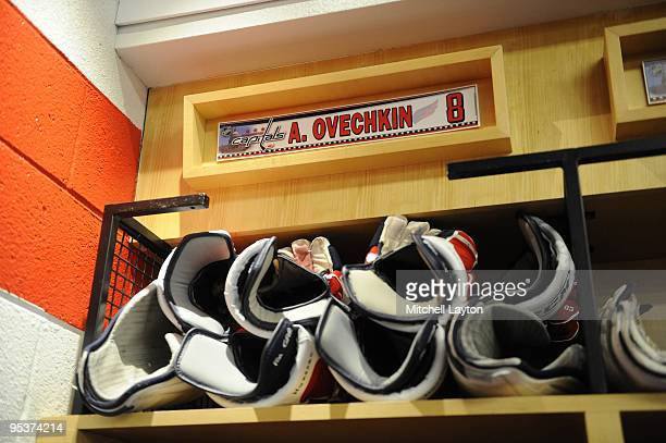 Alex Ovechkins of the Washington Capitals gloves in his locker before a NHL hockey game against the New Jersey Devils on December26 2009 at the...