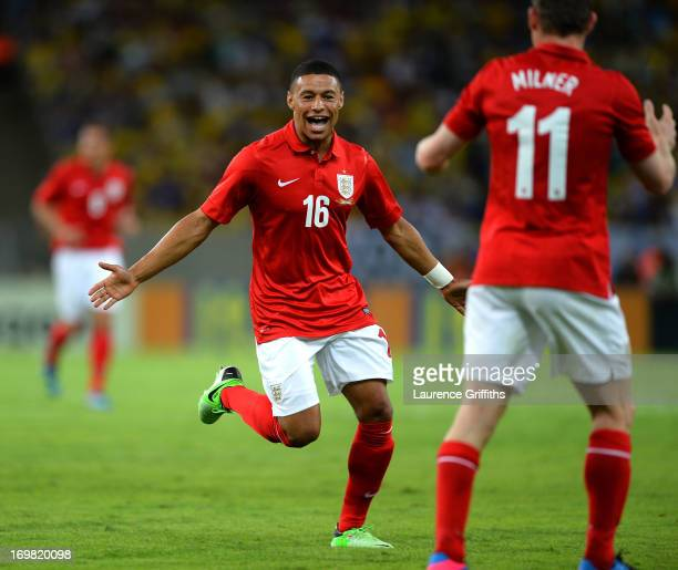 Alex Oxlade Chamberlain of England celebrates scoring the equalising goal during the International Friendly match between England and Brazil at...